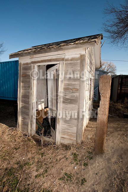 Leaning wooden outhouse at Quinn River Crossing, Nev.