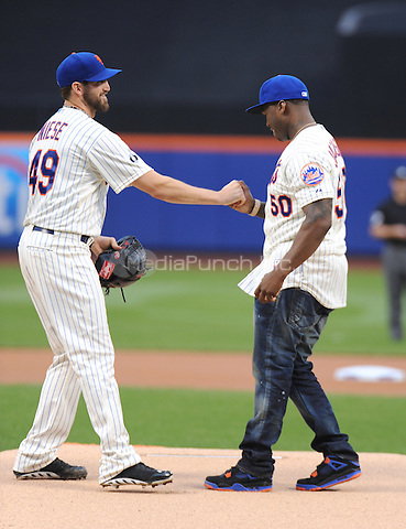 New York, NY- May 27: NY Mets pitcher Jonathan Niese hands the ball to Curtis &quot;50Cent&quot; Jackson before he throws out the first pitch at the New York Mets-Pittsburgh Pirates game at Citi Field on May 27, 2014 in support of his upcoming post-game concert at Citi-Field in Flushing, New York. <br /> Credit: John Palmer/MediaPunch