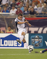 New England Revolution midfielder Chris Tierney (8) crosses the ball. Monarcas Morelia defeated the New England Revolution, 2-1, in the SuperLiga 2010 Final at Gillette Stadium on September 1, 2010.