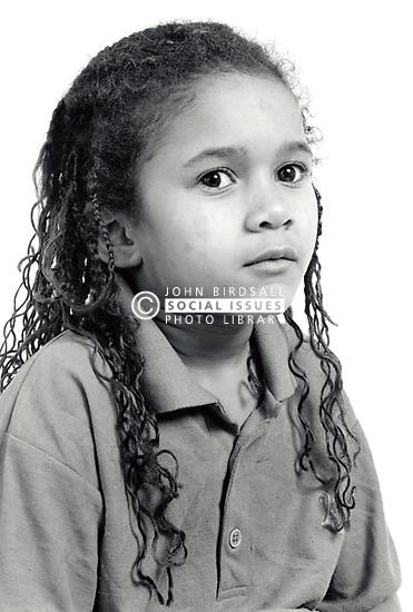 Studio portrait of small girl UK 1990s