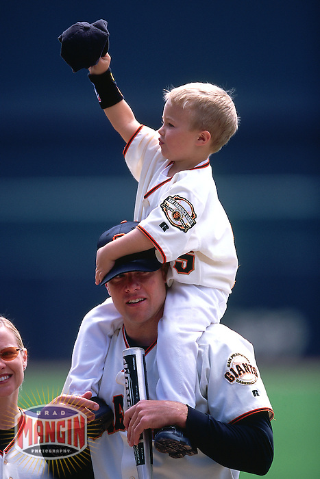 SAN FRANCISCO, CA - J.T. Snow of the San Francisco Giants holds his son on his shoulders before a game at Pacific Bell Park on April in 2002 in San Francisco, California. (Photo by Brad Mangin)
