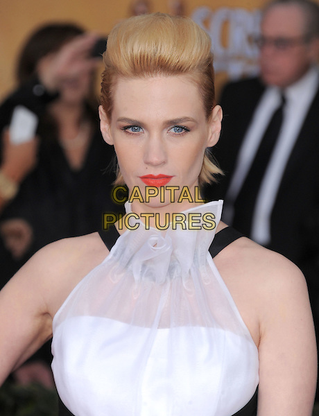 January Jones .Arrivals at the 19th Annual Screen Actors Guild Awards at the Shrine Auditorium in Los Angeles, California, USA..27th January 2013.SAG SAGs headshot portrait white sleeveless halterneck red lipstick ruffle sheer pompadour mullet hair up slicked beauty.CAP/DVS.©DVS/Capital Pictures.