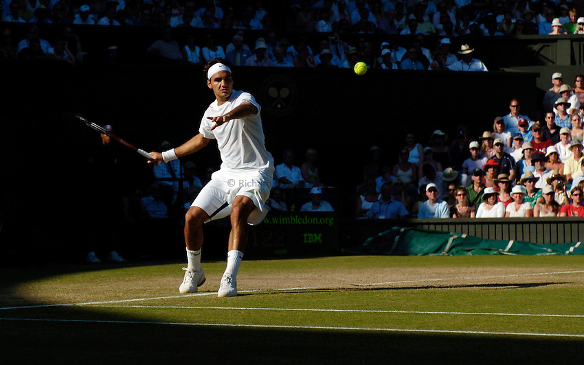 Photo: Richard Lane..Wimbledon Championships. 03/07/2006. .Roger Federer of Switzerland returns.