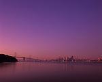 San Francisco skyline at sunrise with city buildings reflected in serene, calm bay from Treasure Island, San Francisco, California USA
