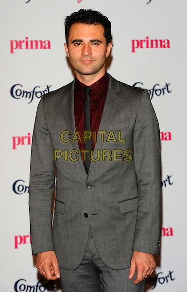 Darius Campbell.Prima High Street Fashion Awards, Battersea Evolutions, Battersea Park, London, England..September 8th, 2011.half length red shirt grey gray tie jacket danesh.CAP/CJ.©Chris Joseph/Capital Pictures.
