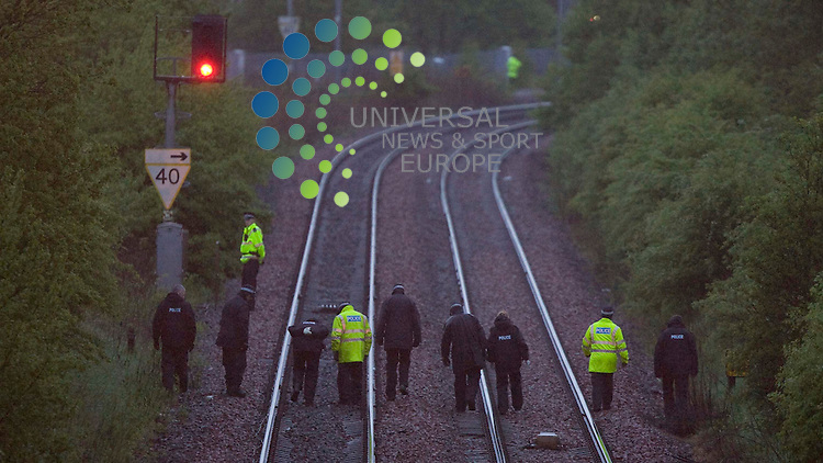Strathclyde police look at the area of the railway tracks at Carfin Railway Station that saw a police officer related shooting the person that was killed by police fire arms officers near or or on the railway tracks .Picture: Universal News and Sport -15/05/2009............... ........... .