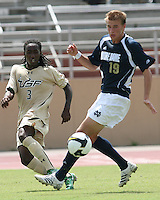 Chris Sutton #19 of the University of Notre Dame fails to stop a cross from Aubrey Perry #3 of the University of South Florida during a Big East NCAA match at the University of South Florida on September20 2009, in Tampa, Florida.South Florida won 2-1 .