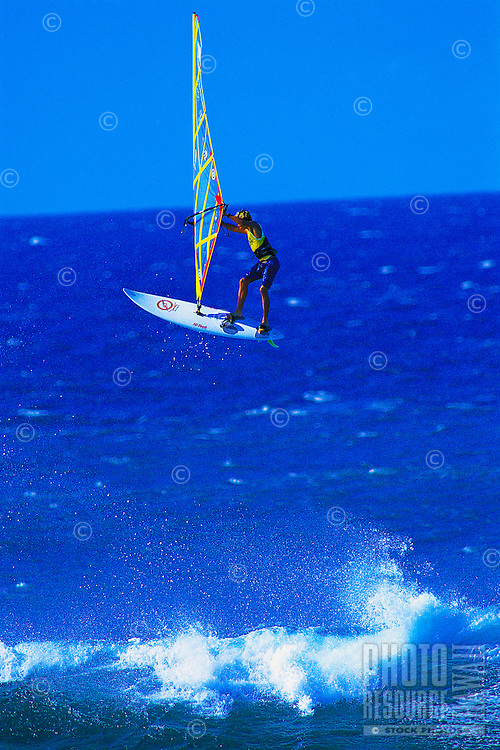 A windsurfer flies into the air at Hookipa Beach Park on Maui