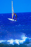 A windsurfer flies into the air at Hookipa Beach Park on Maui