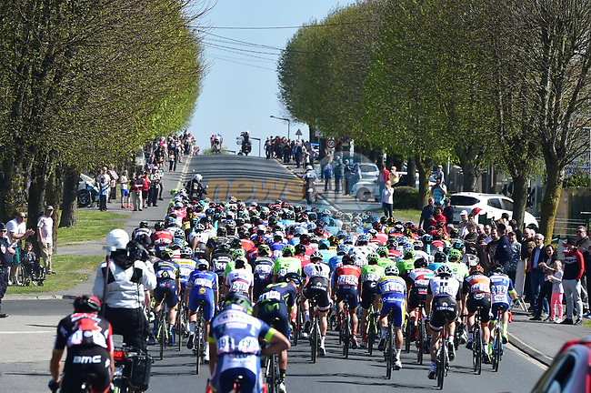 The peloton pass through Ham during the 115th edition of the Paris-Roubaix 2017 race running 257km Compiegne to Roubaix, France. 9th April 2017.<br /> Picture: ASO/P.Ballet | Cyclefile<br /> <br /> <br /> All photos usage must carry mandatory copyright credit (&copy; Cyclefile | ASO/P.Ballet)