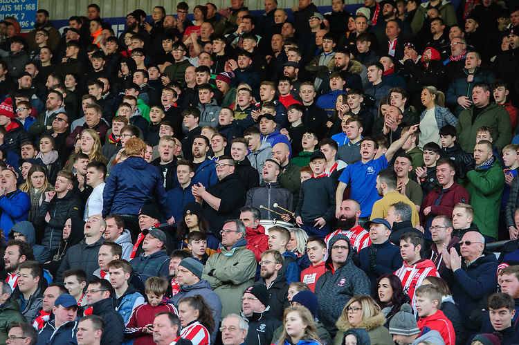 Lincoln City fans watch their team in action<br /> <br /> Photographer Chris Vaughan/CameraSport<br /> <br /> The EFL Sky Bet League Two - Lincoln City v Northampton Town - Saturday 9th February 2019 - Sincil Bank - Lincoln<br /> <br /> World Copyright &copy; 2019 CameraSport. All rights reserved. 43 Linden Ave. Countesthorpe. Leicester. England. LE8 5PG - Tel: +44 (0) 116 277 4147 - admin@camerasport.com - www.camerasport.com