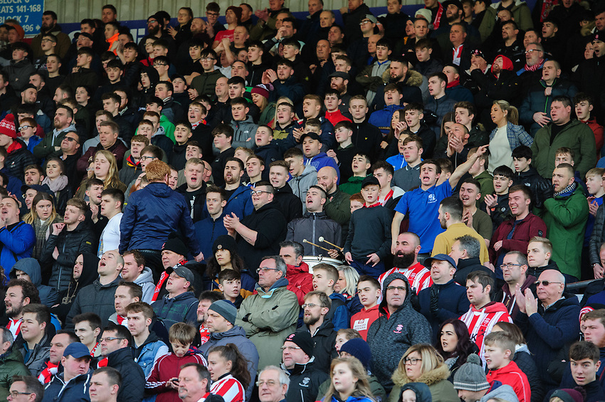 Lincoln City fans watch their team in action<br /> <br /> Photographer Chris Vaughan/CameraSport<br /> <br /> The EFL Sky Bet League Two - Lincoln City v Northampton Town - Saturday 9th February 2019 - Sincil Bank - Lincoln<br /> <br /> World Copyright © 2019 CameraSport. All rights reserved. 43 Linden Ave. Countesthorpe. Leicester. England. LE8 5PG - Tel: +44 (0) 116 277 4147 - admin@camerasport.com - www.camerasport.com