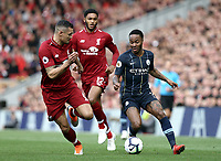 Manchester City's Raheem Sterling under pressure from Liverpool's Dejan Lovren (left) and Joe Gomez<br /> <br /> Photographer Rich Linley/CameraSport<br /> <br /> The Premier League - Liverpool v Manchester City - Sunday 7th October 2018 - Anfield - Liverpool<br /> <br /> World Copyright &copy; 2018 CameraSport. All rights reserved. 43 Linden Ave. Countesthorpe. Leicester. England. LE8 5PG - Tel: +44 (0) 116 277 4147 - admin@camerasport.com - www.camerasport.com