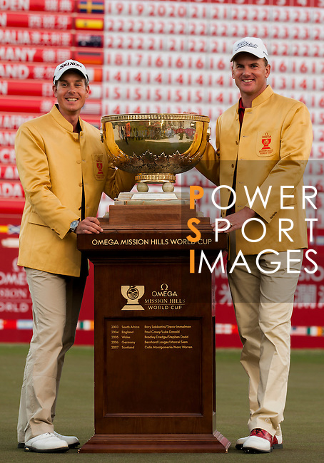 Henrik Stenson and Robert Karlsson of Sweden celebrate with the trophy after winning the final round of the 54th Omega Mission Hills World Cup of Golf on November 30, 2008 in Shenzhen, China. Photo by Victor Fraile