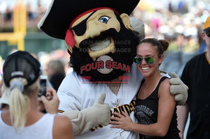 Pittsburgh Pirates fan poses with Bradenton Marauders mascot Marty during a Spring Training game against the Minnesota Twins on March 13, 2015 at McKechnie Field in Bradenton, Florida.  Minnesota defeated Pittsburgh 8-3.  (Mike Janes/Four Seam Images)