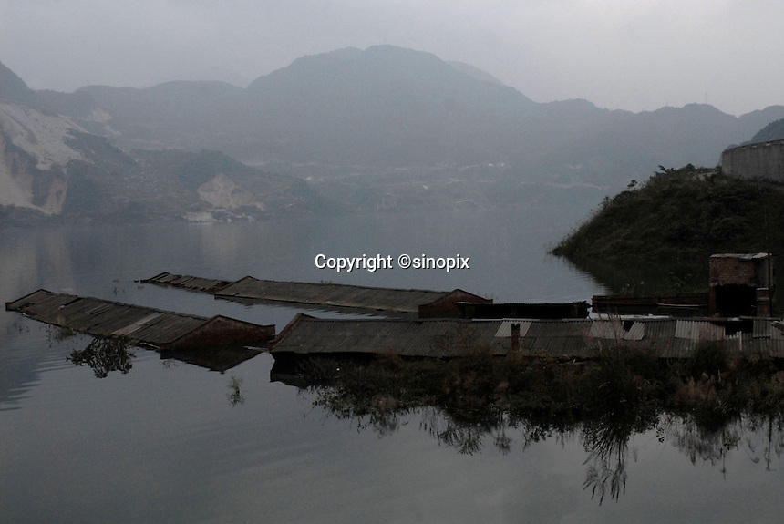 The Yaoji Dam in the mountains of Sichuan near Wolong has flooded a large area displacing many people and their businesses in order to create hydroelectricity for the area. Villagers have demonstrated that they have recieved little compensation and no new homes. The area is close to the famous Wolong Panda reserve..16 Oct 2006