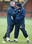 Ally McCoist and Kenny McDowall sorting out a difference of opinions