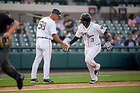 Lakeland Flying Tigers manager Mike Rabelo (58) congratulates Isaac Paredes (3) after hitting a home run in the bottom of the third inning during a game against the Tampa Tarpons on April 5, 2018 at Publix Field at Joker Marchant Stadium in Lakeland, Florida.  Tampa defeated Lakeland 4-2.  (Mike Janes/Four Seam Images)