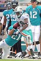 Ted Ginn Jr. runs with the ball after catching a pass as his Miami Dolphins beat the Jacksonville Jaguars 14-10 at Jacksonville Municipal Stadium in Jacksonville, FL, December 13, 2009.  (Photo by Brian Cleary/www.bcpix.com)