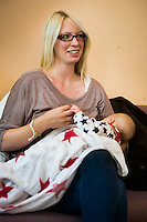 A young woman breastfeeding her baby at a breastfeeding support drop in centre.<br /> <br /> 13/10/2011<br /> Hampshire, England, UK