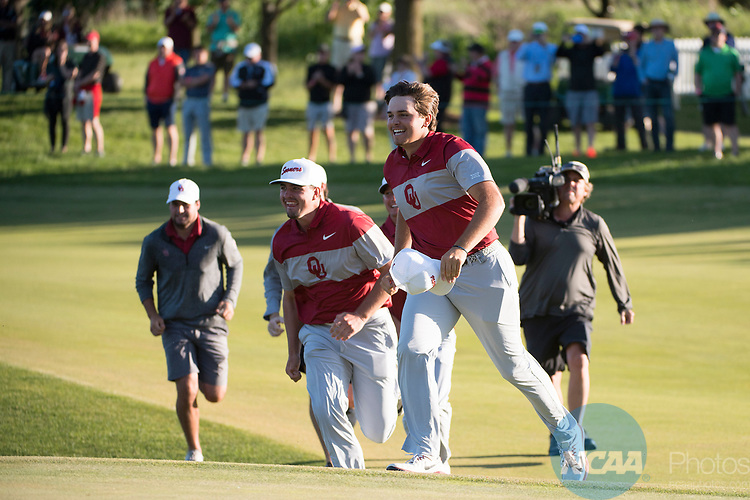 SUGAR GROVE, IL - MAY 31: Blaine Hale of the University of Oklahoma celebrates the Sooners victory during the Division I Men's Golf Team Championship held at Rich Harvest Farms on May 31, 2017 in Sugar Grove, Illinois. Oklahoma won the team national title. (Photo by Jamie Schwaberow/NCAA Photos via Getty Images)