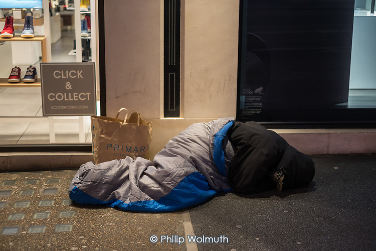 Rough sleeper outside a shoe store, Oxford Street, London.