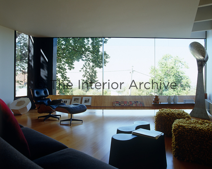 Furniture in the living room is arranged to take advantage of the wide view from the picture window
