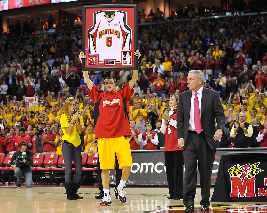Eric Hayes raises his framed jersey during Senior Night at the Comcast Center prior to the last home game of the season against the Duke Blue Devils  in College Park, MD on Wednesday, March 3, 2010. Alan P. Santos/DC Sports Box