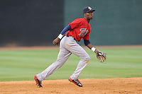 Shortstop Nick Gordon (9) of the Elizabethton Twins chases a grounder in a game against the Johnson City Cardinals on Sunday, July 27, 2014, at Howard Johnson Field at Cardinal Park in Johnson City, Tennessee. Gordon was a first-round pick of the Minnesota Twins in the 2014 First-Year Player Draft.(Tom Priddy/Four Seam Images)