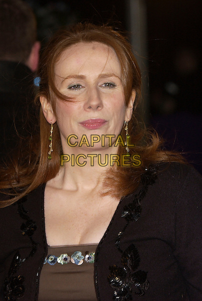 CATHERINE TATE.British Comedy Awards 2005 at the London Television Studios, London, SE1, UK..December 14th, 2005.Ref: FIN.portrait headshot brown dress blue turquoise sequins sequinned black bolero red hair.www.capitalpictures.com.sales@capitalpictures.com.© Capital Pictures.