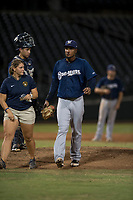AZL Brewers relief pitcher Johan Dominguez (47) is escorted off the field by the team trainer after suffering a bloody nose during an Arizona League game against the AZL Cubs 1 at Sloan Park on June 29, 2018 in Mesa, Arizona. The AZL Cubs 1 defeated the AZL Brewers 7-1. (Zachary Lucy/Four Seam Images)