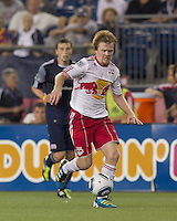 New York Red Bulls midfielder Dax McCarty (11) on the attack. In a Major League Soccer (MLS) match, the New England Revolution tied New York Red Bulls, 2-2, at Gillette Stadium on August 20, 2011.