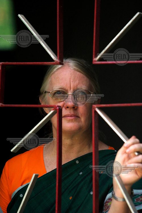Gladys Staines, who has recently been awarded the civilian honour the Padma Shree by the Indian government, looks out of a window in the Graham Staines Memorial Hospital. Her husband Graham and young son were murdered in their trailer in 1999.