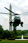 Washington, D.C. - July 23, 2006 -- United States President George W. Bush arrives at the White House aboard Marine One for talks with Prince Saud al-Faisal, Foreign Minister of Saudi Arabia, for a meeting on the situation in the Middle East in the Oval Office in Washington, D.C. on July 23, 2006.  He was returning from a week-end break at his ranch in Crawford, Texas.<br /> Credit: Ron Sachs / CNP