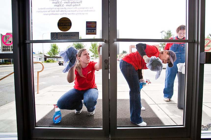 KeyBank volunteers (from left) Amber Darling, Mahnaz Eshetu and Merrilee Avila wash the windows of Highline Medical Group's Roxbury Clinic in White Center during KeyBank's 20th annual Neighbors Make the Difference Day on Tuesday, May 25, 2010. The event involved helping beautify the White Center business district. For years, the bank has provided volunteer help from local branches in Seattle-King County area - and across the country- and this year turned loose some 8,000 volunteers to improve their communities. (Photo by Dan DeLong/Red Box Pictures).