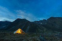 Tent lit at night in the Brooks Range, Gates of the Arctic National Park, Alaska