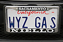 A close up of a 'WYZ GAS' (Wise Gas) license plate on a Smart Car Fortwo. Smart Car enthusiasts packed approximately 130 of their compact cars into Lombard Street in San Francisco for a photo shoot during a car club rally. Although their gas mileage may not be as high as you might expect from a car this small [city 33 mpg/highway 41 mpg (EPA 2008)*] they definitely put SUVs on notice. *smartusa.com. San Francisco, California, USA