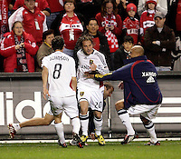 Real Salt Lake midfielder Ned Grabavoy (20) is congratulated by his teammates after converting the game winning penalty kick.  Real Salt Lake defeated the Chicago Fire in a penalty kick shootout 0-0 (5-4 PK) in the Eastern Conference Final at Toyota Park in Bridgeview, IL on November 14, 2009.
