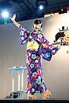 July 27 2012, Tokyo, Japan - The finalist Hidemi Akanuma dances at Yukata Beauty Contest in Koichi Festival. Shoko Kondo, one of the 10 finalists of 270 candidates, wins the annual Yukata Beauty Festival at Koichi Festival in Shimbashi, Tokyo. (Photo by Rodrigo Reyes Marin/AFLO).