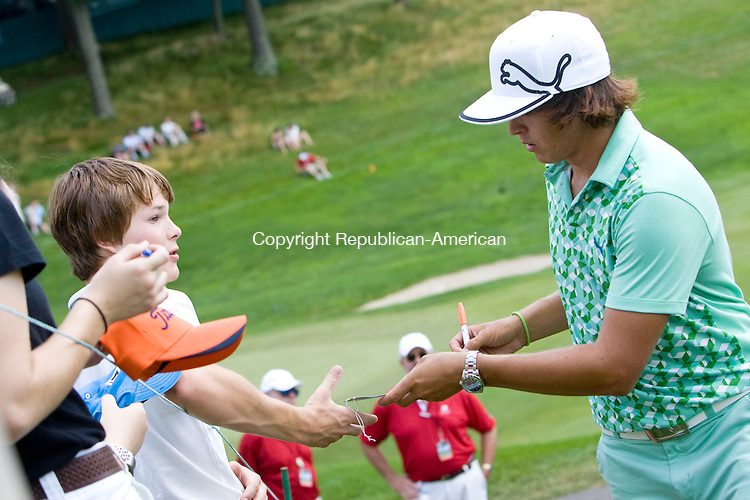 CROMWELL, CT - 23 JUNE 2010 -062310JT04-<br /> Rickie Fowler signs autographs for fans during Wednesday's Travelers Celebrity Pro-Am golf event at TPC River Highlands in Cromwell.<br /> Josalee Thrift Republican-American