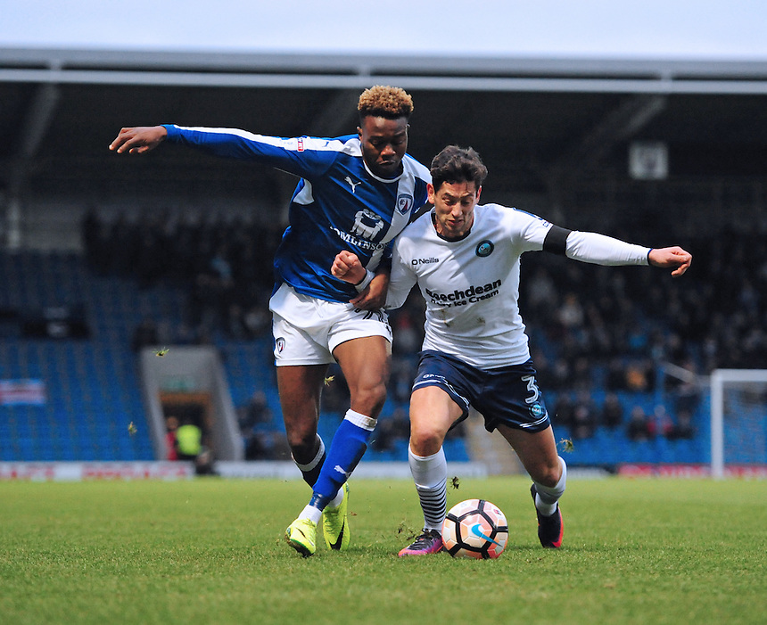 Chesterfield's Gboly Ariyibi vies for possession with Wycombe Wanderers' Joe Jacobson<br /> <br /> Photographer Chris Vaughan/CameraSport<br /> <br /> The Emirates FA Cup Second Round - Chesterfield v Wycombe Wanderers - Saturday 3rd December 2016 - Proact Stadium - Chesterfield<br />  <br /> World Copyright &copy; 2016 CameraSport. All rights reserved. 43 Linden Ave. Countesthorpe. Leicester. England. LE8 5PG - Tel: +44 (0) 116 277 4147 - admin@camerasport.com - www.camerasport.com
