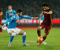 AS Roma's Mohamed Salah challenges Napoli's Elseid Hysaj during the  italian serie a soccer match,between SSC Napoli and AS Roma       at  the San  Paolo   stadium in Naples  Italy ,December 13, 2015