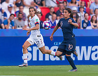 PARIS,  - JUNE 28: Tobin Heath #17 sprints past Amel Majri #10 during a game between France and USWNT at Parc des Princes on June 28, 2019 in Paris, France.
