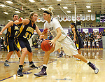 SIOUX FALLS, SD - JANUARY 2:  Teagan Molden #30 from the University of Sioux Falls drives against Hayley McCarron #33 from Augustana in the first half of their game Friday night at the Stewart Center. (Photo by Dave Eggen/Inertia)