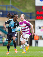 Marcus Bean of Wycombe Wanderers under pressure from Michael Gash of Barnet during the Sky Bet League 2 match between Wycombe Wanderers and Barnet at Adams Park, High Wycombe, England on 16 April 2016. Photo by Andy Rowland.