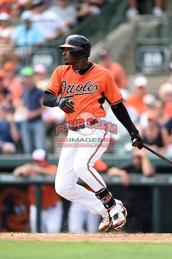 Baltimore Orioles outfielder Adam Jones (10) during a spring training game against the Pittsburgh Pirates on March 23, 2014 at Ed Smith Stadium in Sarasota, Florida.  Baltimore and Pittsburgh tied 7-7.  (Mike Janes/Four Seam Images)