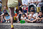 Children enjoy some entertainment inside Inokashira Park in the trendy neighborhood of Kichijoji in Musashino City,  Tokyo, Japan on 16 Sept. 2012.  Photographer: Robert Gilhooly
