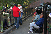 (171015RREI5533)  La Esquina where Latinos have gathered for decades at the corner of Mt. Pleasant St. and Kenyon St. NW. to play chekers (damas). Cabo Luis (light shirt).  Washington DC Oct. 15 ,2017 . ©  Rick Reinhard  2017     email   rick@rickreinhard.com