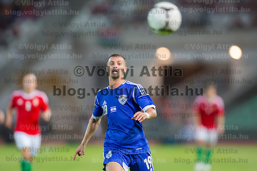 Israel's Elad Gabay (C) runs for the ball during a friendly football match Hungary playing against Israel in Budapest, Hungary on August 15, 2012. ATTILA VOLGYI
