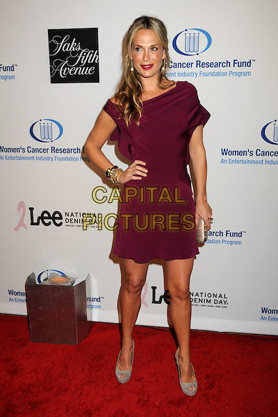 MOLLY SIMS.EIF's Women's Cancer Research Fund Benefit held at the Beverly Wilshire Hotel, Beverly Hills, California, USA..January 27th, 2010.full length dress hand on hip simms purple maroon grey gray shoes clutch bag bracelets gold .CAP/ADM/BP.©Byron Purvis/AdMedia/Capital Pictures.
